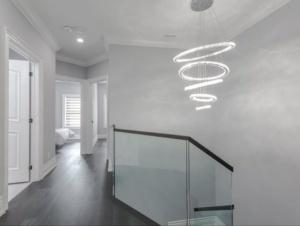 seamless glass railings with wood handrail