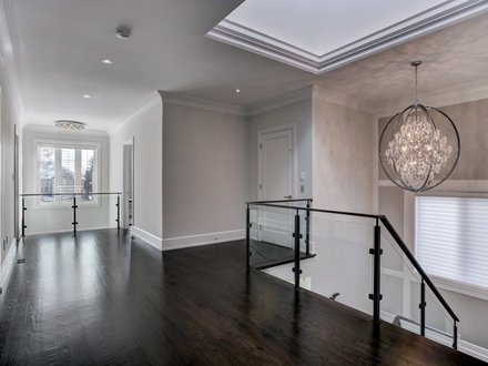 interior glass railings with black posts and handrails