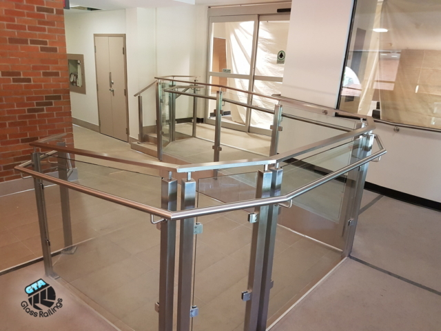 Glass railings on accessibility ramp