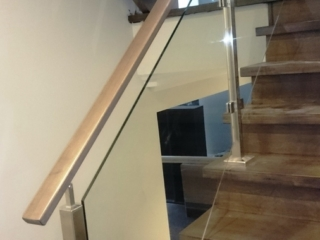 stainless steel railing with wood handrail