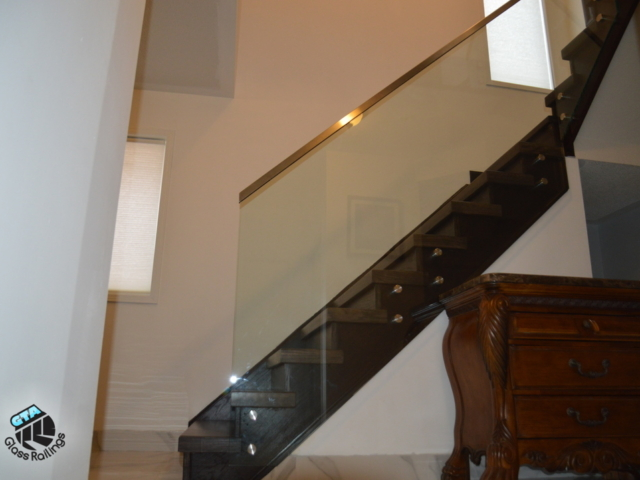framless glass railing with stainless steel handrail