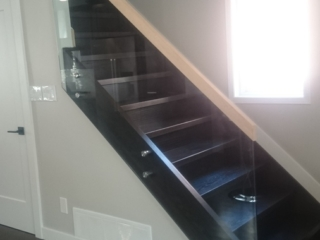 standoff glass railing with wood handrail