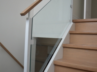 white glass railing with wood handrail
