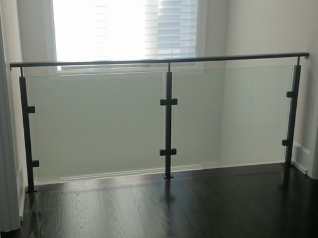 glass railing on a mezzanine
