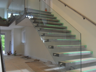 glass railing on floating stairs