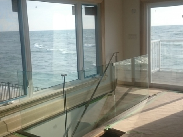 glass railings lakefront house