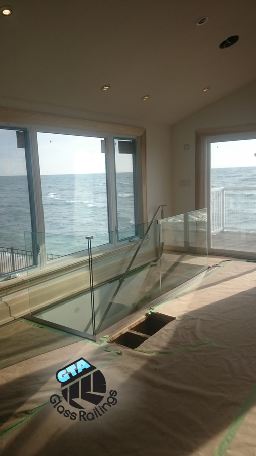 glass railing in a lakefront house