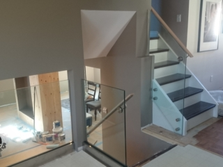 frameless glass railing with wood handrail
