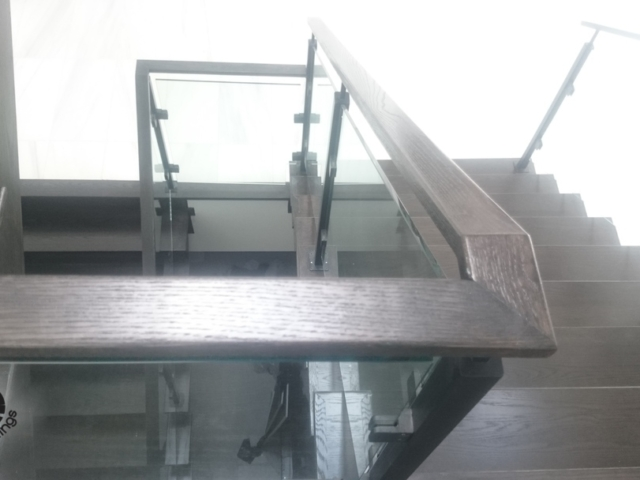 glass railing with wood handrail