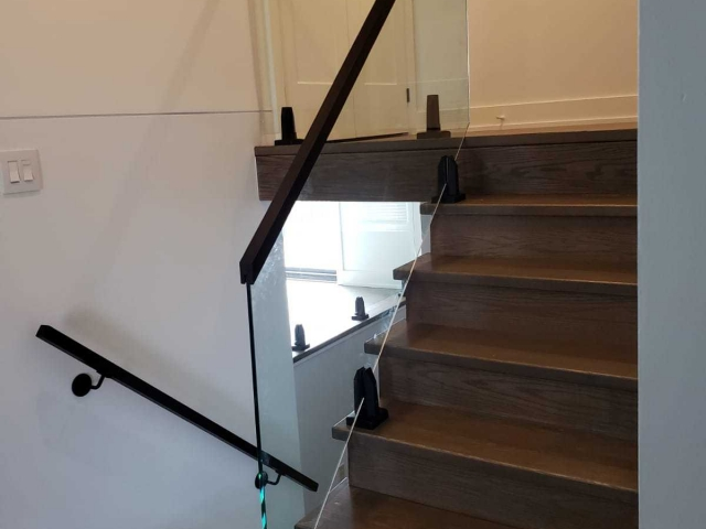 Glass railing wood handrail