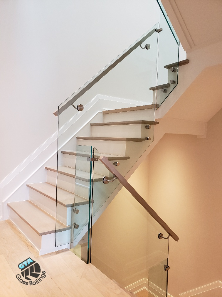 interior glass railings with wood handrail