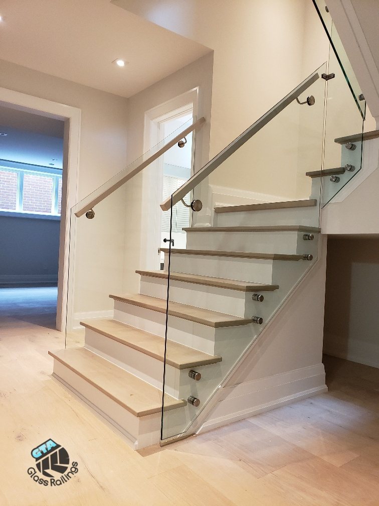 indoor frameless glass railing wood handrail